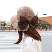 Елегантна дамска шапка с голяма панделка