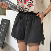 Широки дамски къси панталони с декорация дантела и връзки в бял и черен цвят
