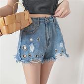 Къси дамски панталони с декорация метални пръстени, с висока талия и в син цвят