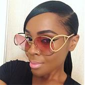 Много стилни дамски слънчеви очила с интересна форма на рамката