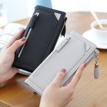 Дамски портфейл с пискюл и ципове в четири цвята
