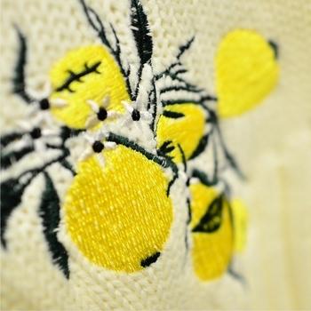 Стилен дамски пуловер в широк модел с бродерия в жълт цвят