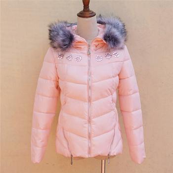 Χειμερινό γυναικείο μπουφάν με γούνα και με  πολύ όμορφα λαμπερά βότσαλα