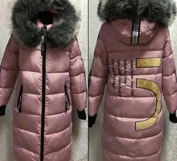 Πολύ μοντέρνο και ζεστό γυναικείο χειμωνιάτικο μπουφάν  με γούνα στο κολάρο