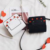 Много актуална и модерна мини дамска чантичка с дълга дръжка за през рамо в черен и бял цвят
