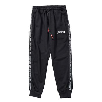 Стилен спортен панталон в свободен модел с надписи в два цвята