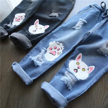 ccc01e2fc71 Κομψά παιδικά τζιν για κορίτσια - σχισμένα με ελαστική μέση και εφαρμογή  της γάτας