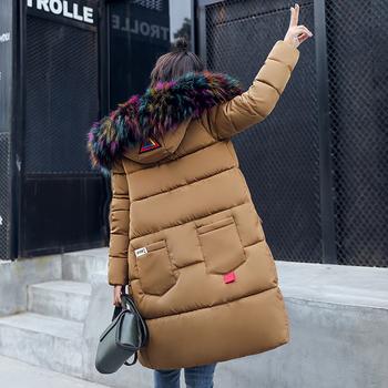 Γυναικείο μακρύ χειμωνιάτικο  μπουφάν  με εφαρμογές και κουκούλα