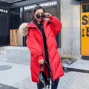 Дълго и широко зимно яке за дамите с качулка и пух