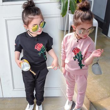Спортно-елегантен детски комплект в черен и розов цвят