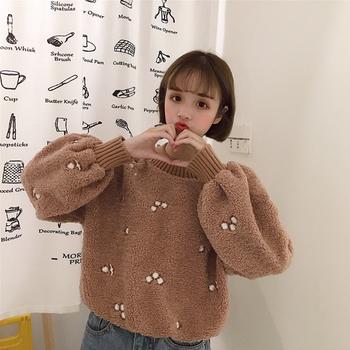 Много топъл дамски пуловер с О-образна яка и в широк модел