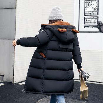 Зимно дамско дълго яке с камуфлажни десени и интересни ушички на качулката
