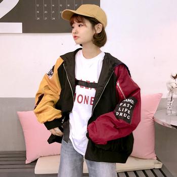 Дамско интересно яке в широк модел с цветни ръкави